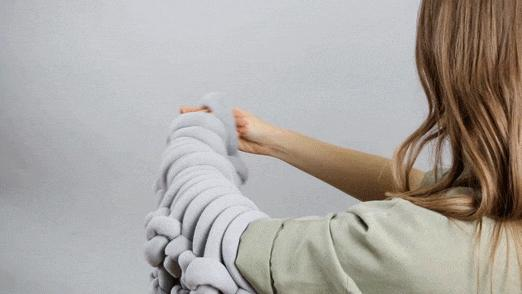 how to arm knit a blanket using Braid