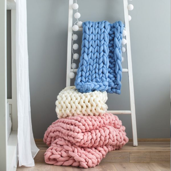 three chunky knitted merino blankets by Ohhio